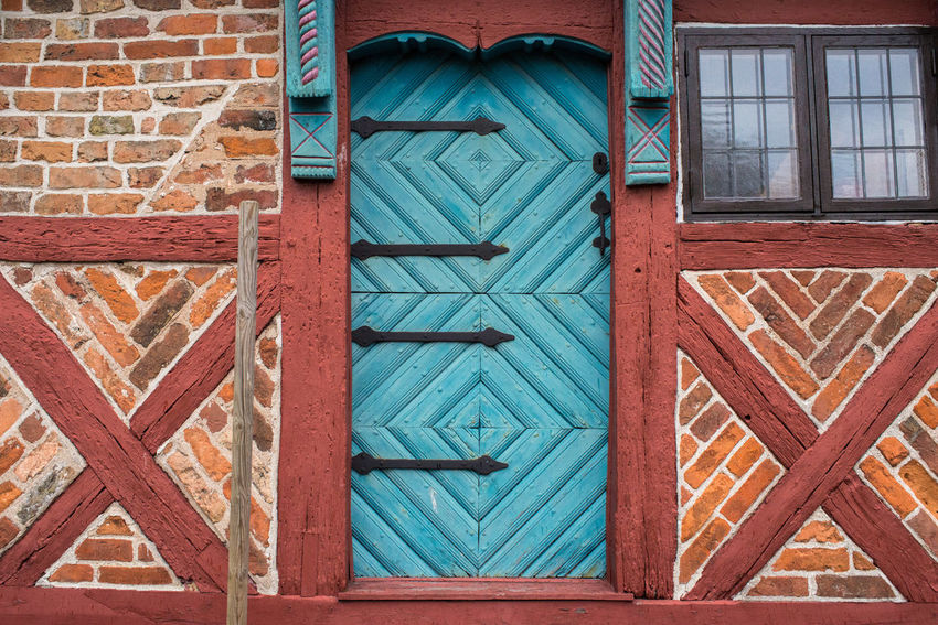 Multi Colored Blue Door Brick Wall Entrance Red Blue Build Structure Building Exterior Carved Wood Door House Medieval Architecture Outdated Outdoors Outdoors Photograpghy  Street Timber Framing Town Window Wood - Material Wooden Door Wooden Texture