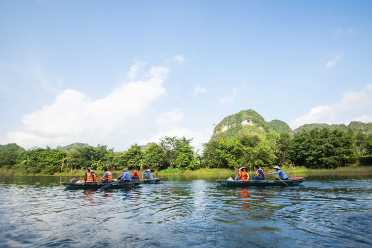 travel at Trang An, Ninh Binh, Vietnam Nautical Vessel Water Group Of People Transportation Sky Tree Real People Mode Of Transportation Day Plant Waterfront Leisure Activity Cloud - Sky Nature River Lifestyles Beauty In Nature Medium Group Of People People Outdoors