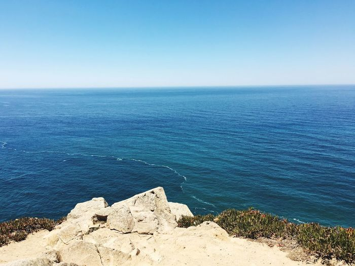 Rock Sea Water Beauty In Nature Horizon Over Water Scenics - Nature Tranquility Horizon Sky Tranquil Scene Blue Nature Day Land Idyllic Sunlight Clear Sky No People High Angle View Outdoors