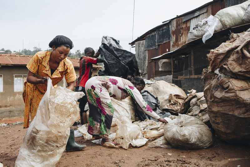Africa African Built Structure Business Community Dirt Dirty Favela Mud Outdoors Plastic Poor  Poverty Real People Recycle Recycling Sacks Shack Slum Slums Social Business Social Issues Street Trash Women