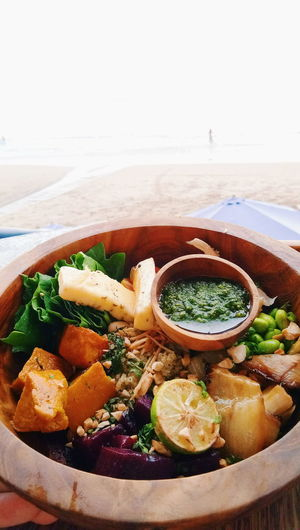 Lunch by the beach side. Beach Lunch Breakfast Kale Quinoa Quinoa Bowl Wooden Bowl Healthy Food Vegetarian Vegan Vegan Food Squash Pesto Basil Beet Kale Edamame Colorful Fun Colorful Food Food Food And Drink Food Beach No People Freshness Water Healthy Eating Food Stories