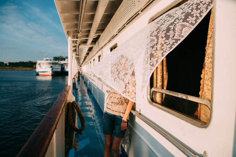Women behind the curtain on the river ship EyeEmBestPics EyeEmNewHere Beautiful Woman Curtain Day Mode Of Transport Nautical Vessel No People Outdoors River Ship Sky Transportation Water Wind