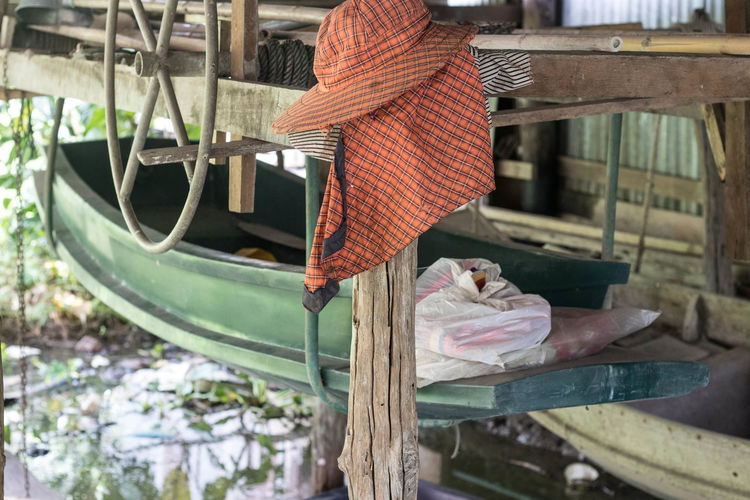 Rear view of woman working on bench