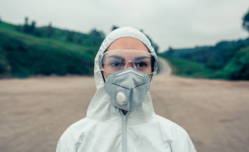 Female scientist wearing protective workwear while standing outdoors