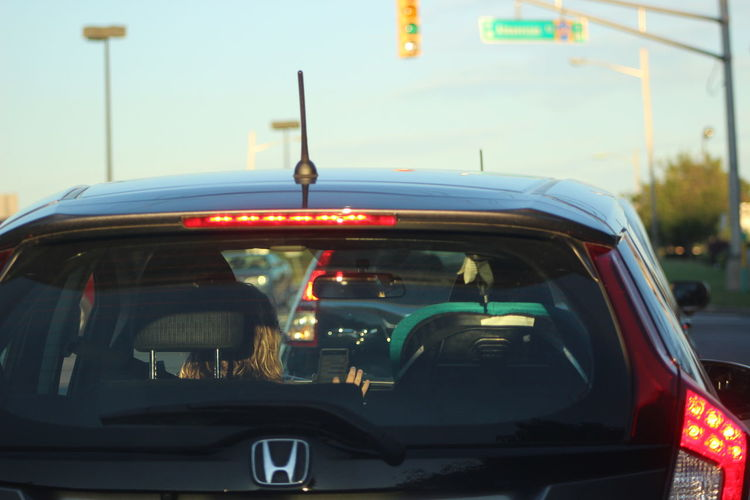 Car Car Interior City Life Day Land Vehicle Mode Of Transport Outdoors Rush Hour Shame On You Stationary Street Light Tail Light Texting And Driving Traffic Transportation Travel Vehicle Hood Windshield