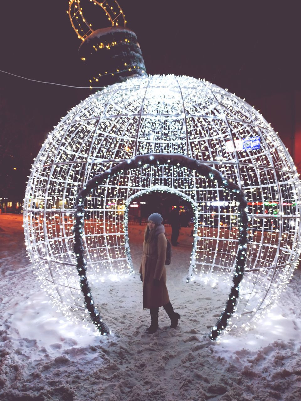 rear view, real people, standing, architecture, full length, people, lifestyles, illuminated, water, leisure activity, motion, men, women, adult, nature, built structure, night, decoration, outdoors