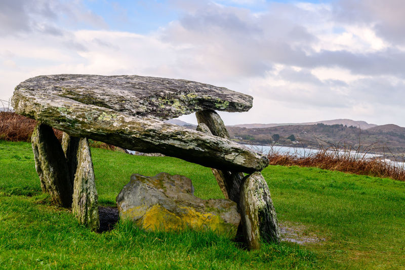 Altar wedge tomb, Schull, West Cork, Ireland. Set on the rugged coastline of Toormore Bay in West Cork, this neolithic tomb is on the Wild Atlantic Way. Altar Wedge Tomb Ireland Neolithic Ireland Schull Ireland Toormore Toormore Bay Wild Atlantic Way Wild Atlantic Way, Ireland, Cork, West Cork, Seascape, Landscape. Sea, Mountains, Celtic Legends Cloud - Sky Gallery Grave Landscape Neolithic Neolithic Stones Outdoors Prehistoric Prehistoric Monument Prehistory Sky Stone Stone Monument Tranquil Scene Tranquility Wedge Tomb