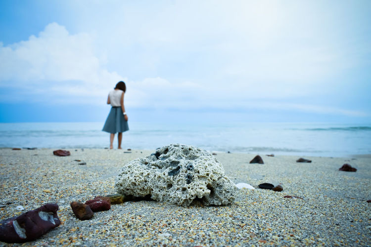 EyeEmNewHere Sea Beach One Person Sky Land Rock Solid Beauty In Nature Real People Nature Rock - Object Lifestyles Water Full Length Scenics - Nature Horizon Cloud - Sky Rear View Horizon Over Water Day Outdoors
