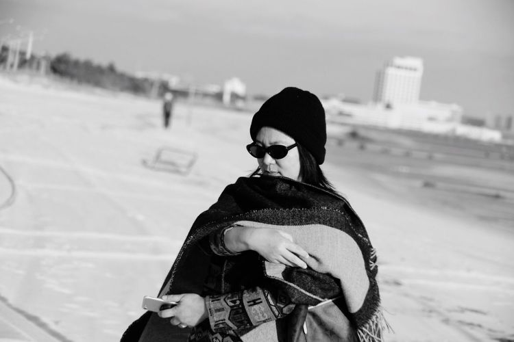 Black And White Travel Portrait People Fashion Street Photography One Person Real People Lifestyles Winter Leisure Activity Cold Temperature Focus On Foreground Land Nature Clothing Sunglasses Glasses Women Snow Young Adult Waist Up Sunlight Casual Clothing Warm Clothing Day