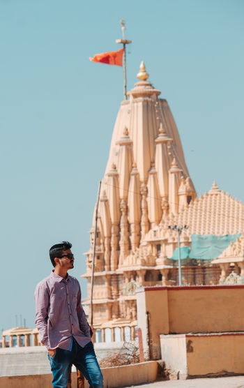 Man standing against temple in city