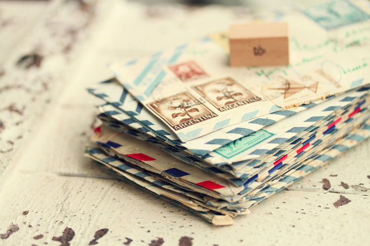 Close-up of postage stamps on envelope over table