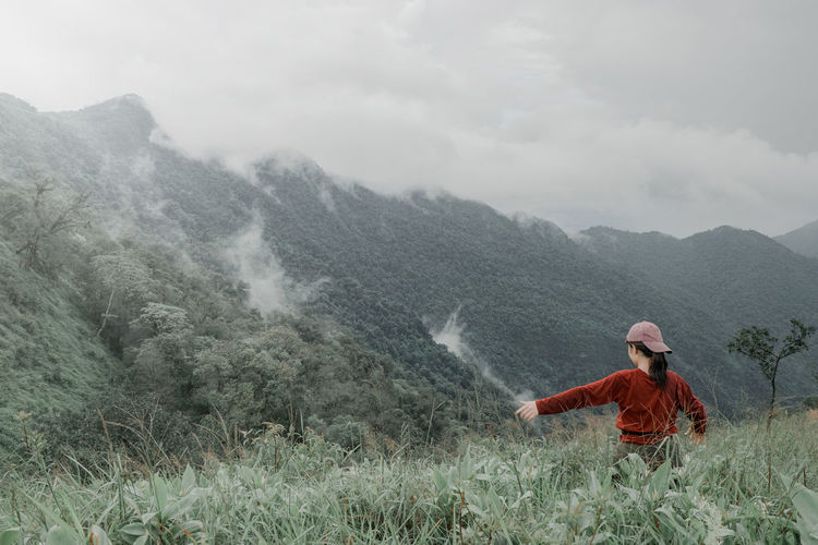 Beauty In Nature Day Environment Fog Land Landscape Men Mountain Mountain Range Nature Non-urban Scene One Person Outdoors Plant Rain Real People Scenics - Nature Standing Tranquil Scene Tranquility