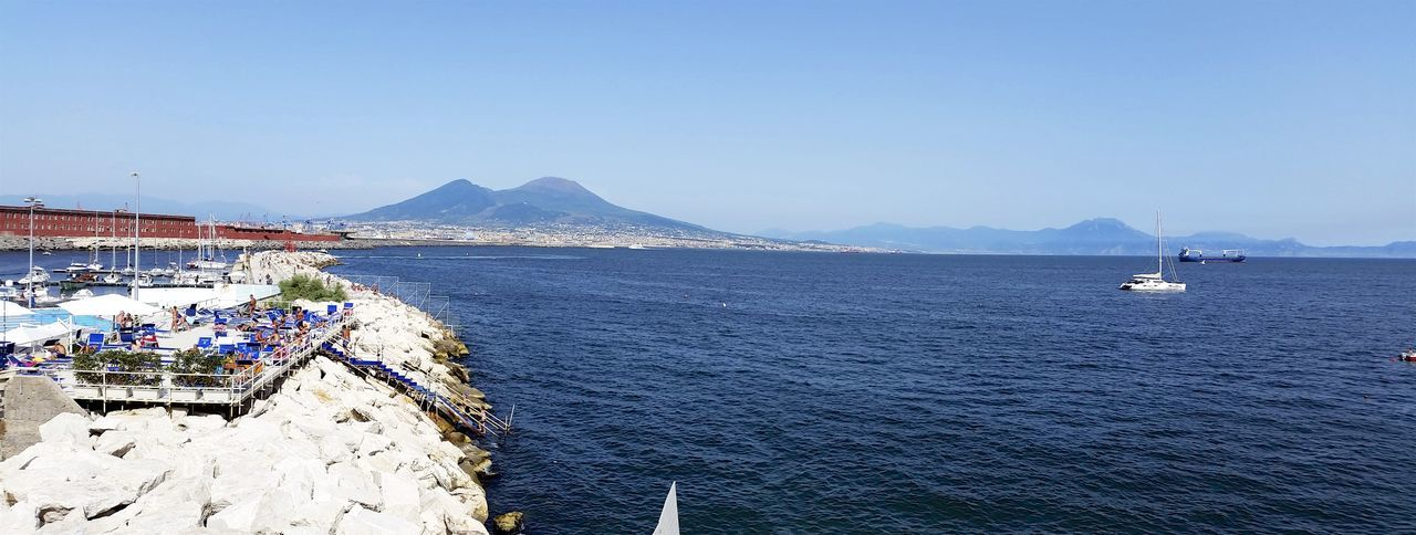 Bay Of Naples Beauty In Nature Blue Building Exterior Clear Sky Coastline Copy Space Day Harbor Mode Of Transport Mountain Mountain Range Nature No People Outdoors Residential District Scenics Sea Shore Tranquil Scene Tranquility Vesuvio Water Waterfront