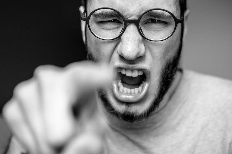 Adult Adults Only Anger Close-up Day Evil Eyeglasses  Furious Headshot Human Body Part Human Face Human Hand Indoors  Looking At Camera Making A Face Mouth Open Old-fashioned One Person People Portrait Real People Screaming Shouting Studio Shot Young Adult The Portraitist - 2017 EyeEm Awards This Is Masculinity