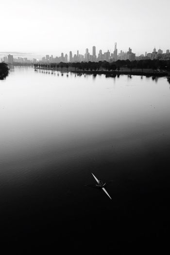 Melbourne Leisure Sport Leisure Activity Rowing Blackandwhite Monochrome Water Reflection Waterfront Sky Nature Tranquility Nautical Vessel Standing Water Beauty In Nature Building Exterior Built Structure Outdoors Architecture Tranquil Scene Day River Clear Sky
