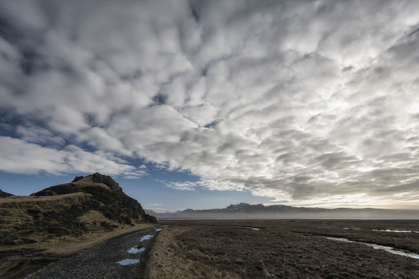 Landscape in Iceland Beauty In Nature Calm Cloud Cloud - Sky Cloudy Coastline Day Idyllic Landscape Mountain Nature No People Non Urban Scene Non-urban Scene Outdoors Overcast Remote Scenics Sea Shore Sky Tranquil Scene Tranquility Water Weather