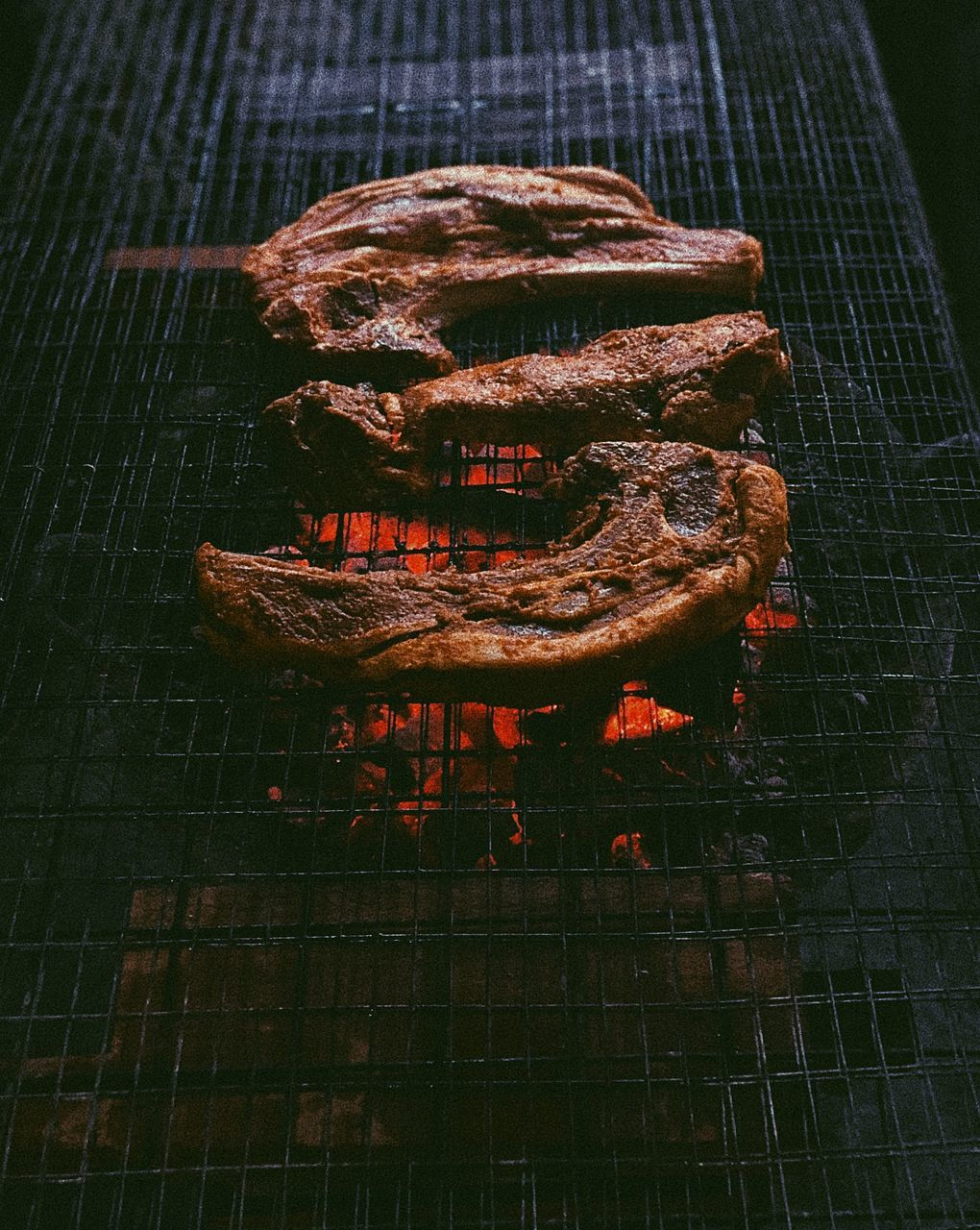 CLOSE-UP OF AN ANIMAL ON GRILL