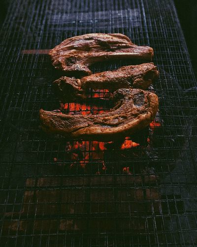Close-up of an animal on barbecue grill