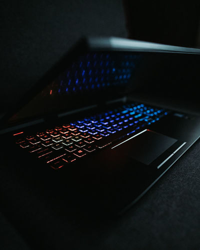 High angle view of illuminated laptop on table