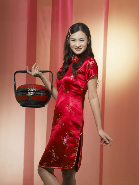 young chinese woman greeting during chinese new year Greeting Antique Gong Xi Fa Cai Happiness Standing Woman Basket Beautiful Woman Cheongsam Chinese Ethnicity Chinese New Year Color Background Curtain Fashion Heritage Looking At Camera Nyonaya Basket Portrait Qipao Red Smile Smiling Three Quarter Length Young Adult Young Women