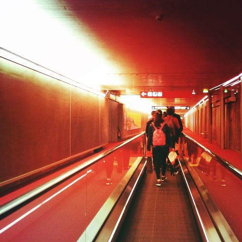 Blurred motion of woman in subway tunnel