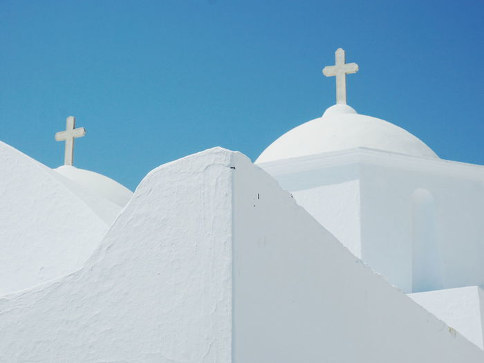 Church in Chora , Amorgos island Built Structure Clear Sky Cross Day Low Angle View No People Outdoors Place Of Worship Religion Spirituality Sunlight White Color Whitewashed