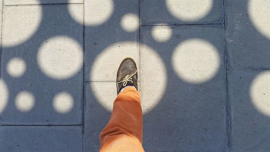 Human foot in spot light against sunlight