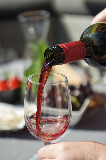 Alcohol Body Part Bottle Close-up Drink Finger Focus On Foreground Food And Drink Glass Hand Holding Human Hand Pouring Red Wine Refreshment Wine Wine Bottle Wineglass Winetasting