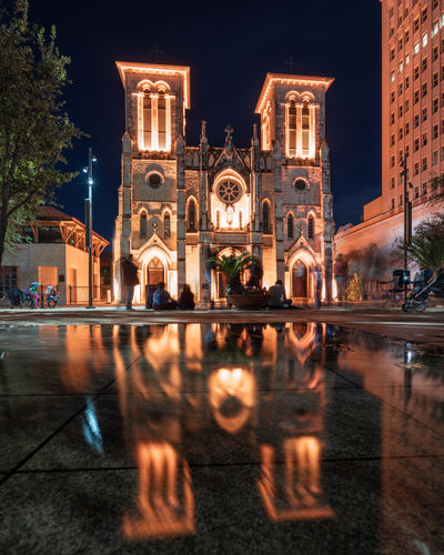 San Fernando Cathedral in San Antonio Built Structure Building Exterior Architecture Sky Reflection Water Building Religion Spirituality History Travel Destinations Nature The Past City Outdoors Cathedral Church Architecture Spanish Light Illuminated