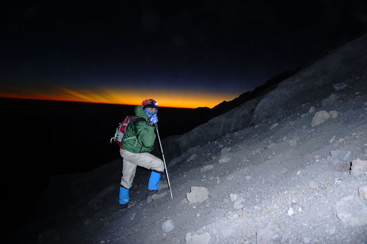 Chasing sunrise at peak mahameru, semeru, east jawa, indonesia #Mountaineers #Sunrise INDONESIA Adventure Backpack Beauty In Nature Cold Temperature Day Full Length Healthy Lifestyle Hiking Leisure Activity Lifestyles Men Mountain Nature One Man Only One Person Only Men Outdoors People Real People Sky Breathing Space