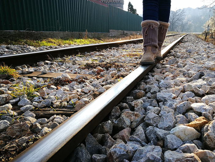 Low section of man standing on railway tracks