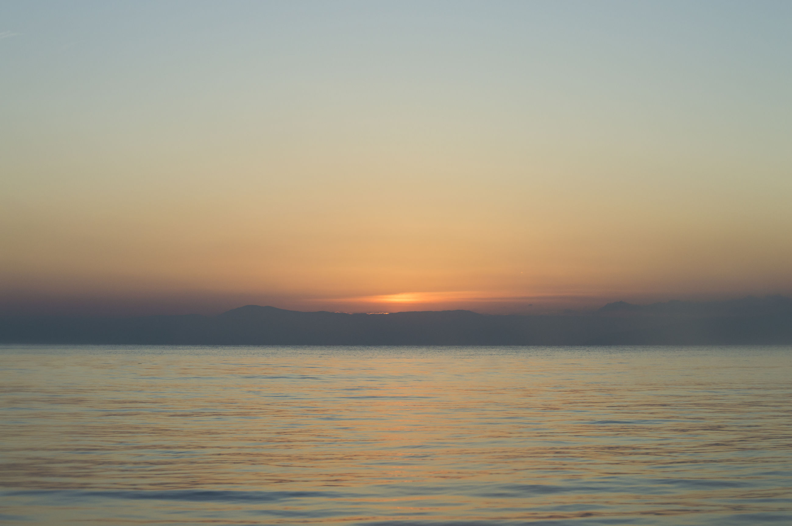 VIEW OF SEA AGAINST SKY DURING SUNSET