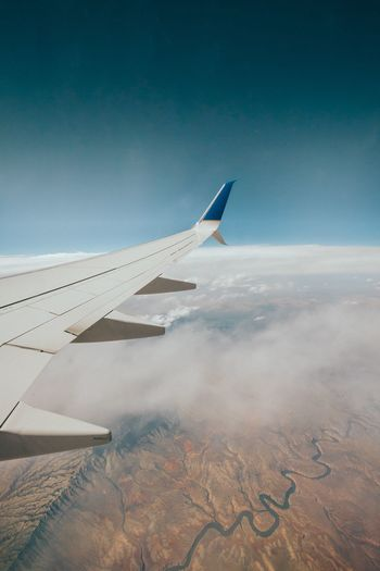 EyeEm Selects EyeEm Selects Airplane Aerial View Airplane Wing Transportation Journey Sky No People Nature Travel Air Vehicle Aircraft Wing Day Mid-air Flying Mode Of Transport Landscape Blue The Natural World Outdoors Beauty In Nature