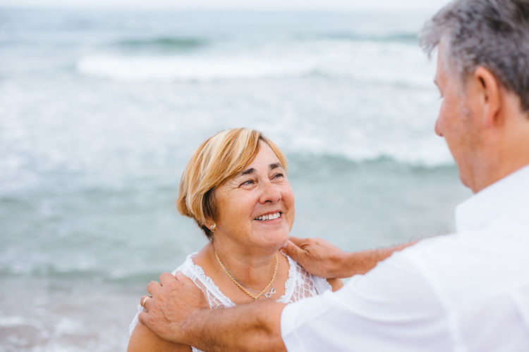 Two People Sea Water Headshot Beach Adult Smiling Women Mature Adult Happiness Togetherness Land Portrait Emotion Love Leisure Activity Mature Men Couple - Relationship Females Positive Emotion Mature Couple Wife Outdoors