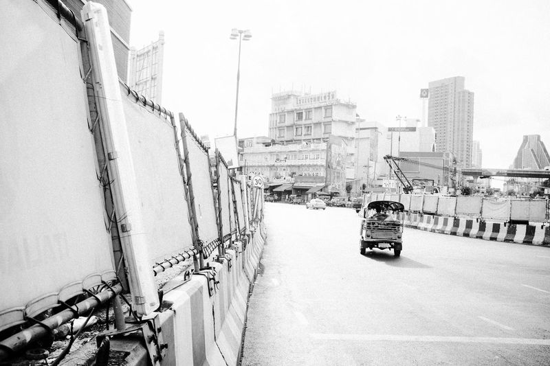 Central Bangkok VSCO X100S Architecture Building Exterior Built Structure City Day Fujifilm_xseries Land Vehicle Men Mode Of Transport Motorcycle One Person Outdoors People Public Transportation Real People Road Scooter Sky Transportation