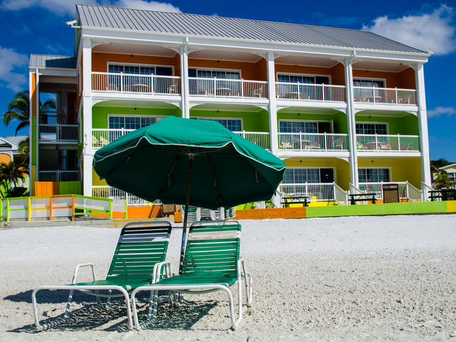 Beach Beach Life Day Florida Green Hotel Lounge Chair No People Orange Outdoors Sand Sky Umbrella Yellow