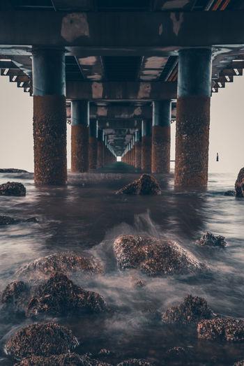 Below view of bridge over sea