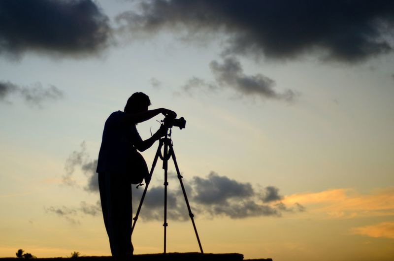 Scenic view of photographer silhoutte on the sunset background. Wallpaper Background Malaysia Beach ASIA Sunset Sunrise Photography Photographer DSLR Camera Alone Man Silhouette Action Action Shot  Cloud - Sky