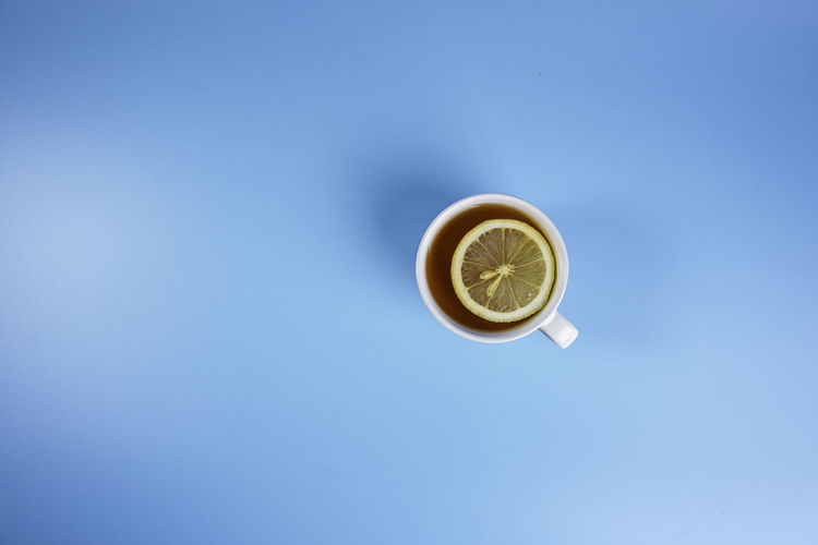 Directly above shot of tea cup against blue sky