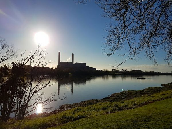 On the Waikato River at Huntly on Sunny Afternoon 2016 08 31 Sky Sunlight And Shadow Water Water Reflections Reflections Chimneys Smoke Stack Riverside Water Sun Sunlight Blue Architecture Lake Clear Sky Building Exterior Reflection Tranquility Scenics Tranquil Scene Sunbeam