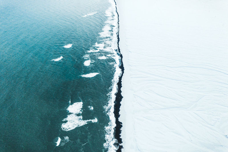 High angle view of frozen water on land