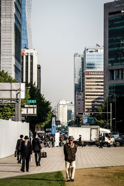 Streetlife in Seoul Architecture Building Building Exterior Built Structure City City Life Contemporary Leisure Activity Modern Office Building Outdoors Residential Structure Skyscraper Street Street Photography Streetfashion Streetlife Streetphotography Tall Tall - High Tower Travel Travel Photography Traveling Urban