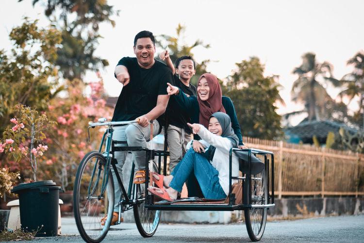 Happy Family On Pedicab
