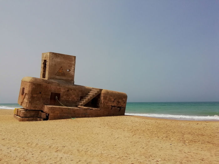 Bunker Architecture Beach Beauty In Nature Bunkers  Clear Sky Copy Space Day Horizon Horizon Over Water Land Nature No People Outdoors Sand Scenics - Nature Sea Sky Tranquil Scene Tranquility Water Wood - Material