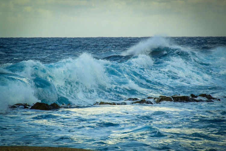 Scenic view of sea with splashing waves