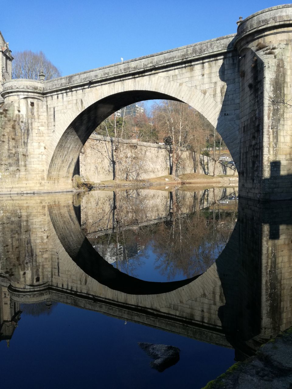 reflection, arch, architecture, water, built structure, day, bridge - man made structure, sky, clear sky, no people, outdoors, tree, nature