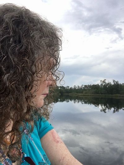Side view of girl looking at lake