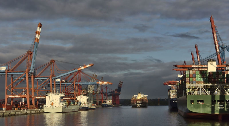 container harbor of the port of Hamburg - Ship is being towed to a landing stage Industry Transportation Water Freight Transportation Shipping  Commercial Dock Crane - Construction Machinery Pier Container Nautical Vessel Harbor Hamburg Germany Red Shipping  Cargo Container
