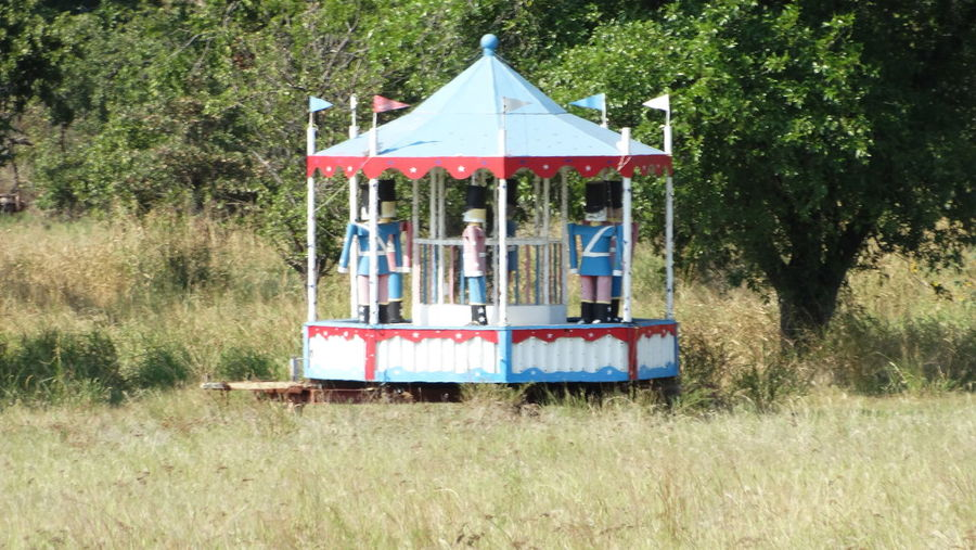 , Military Amusement Ride Antique Toys Carousel Cultures Decoration Decorative Fairground Field Trip In A Row Memorial Metal Odd Adventures Oddities Old-fashioned Outside Pastel Power Safety Soldier Strange Symbol War