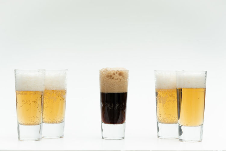 Diversity Studio Shot Glass Refreshment Drinking Glass Drink White Background Food And Drink Still Life Household Equipment Indoors  Frothy Drink Side By Side No People Beer Glass Freshness Alcohol Close-up Beer Cut Out Group Of Objects Pint Glass Comparison